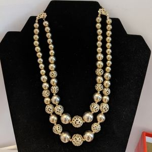 Gold tone double strand necklace.